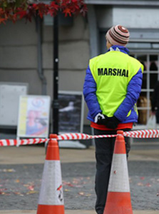 One of our marshals awaiting the arrival of the runners in Abingdon town centre. © SussexSportPhotography.